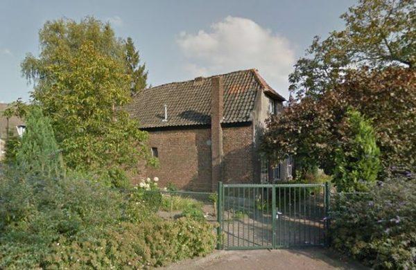 Het 'oudste pand van Asten' in 2014, momenteel is het gemeentelijk monument afgedekt met zeil