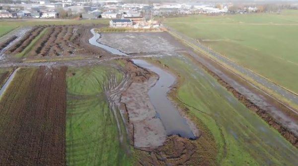 Het uitgraven van de Hellenbeek in Elburg