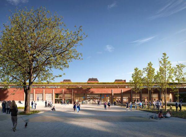 Impressie van de tweede volwaardige entree aan de achterzijde van het station. In de verte het monumentale stationsgebouw