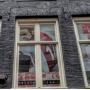 Heemschut maakt bezwaar tegen afplakken ramen van Ajax fanshop in Amsterdam